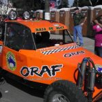 "This orange buggy read ""Baja or Bust""."