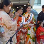The girl on the right with the sash and orange kimono was Miss Kimono 2013. The red kimono girl was the first runner-up.