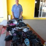 Dean Tinney (director for the school) surveys all the shoes.