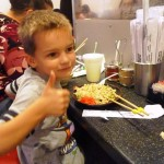 AJ learns how to use chopsticks.