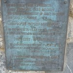 The original dedication plaque for the band shell from 1920.