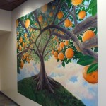 A painting of orange trees inside the new Marcy Branch Library.