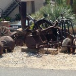 Found this rusting farm equipment decorated in front of a house.