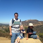 John, Madison, and AJ taking a break to look at the Hollywood sign.