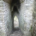 The hallways are shaped in a arch so that the ruler could come out with his headdress on and not rumple the feathers.