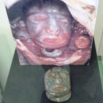 This death mask idol was used to protect a burial site. The red bark covering it is poisonous to the touch.