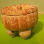 A pumpkin shaped offering pot.