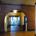 A view towards the Florence ballroom shows a classic brick archway.